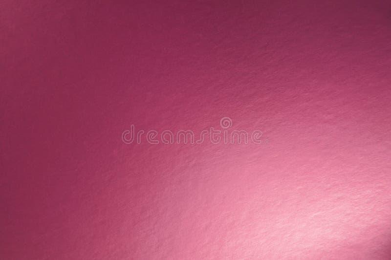 Textur av rosa metalliskt foliepapper arkivbilder