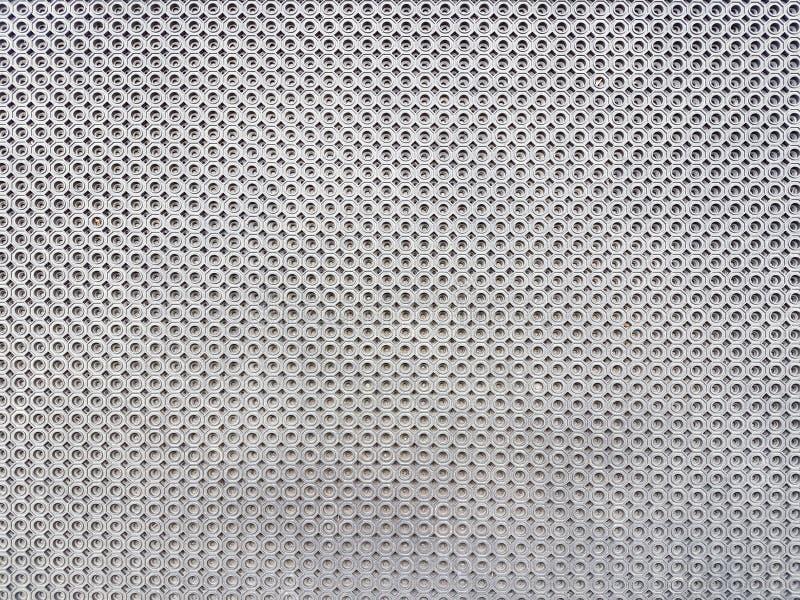 Textur av silverfärg från runda små beståndsdelar Dekorativa material för konstnärlig design royaltyfri fotografi