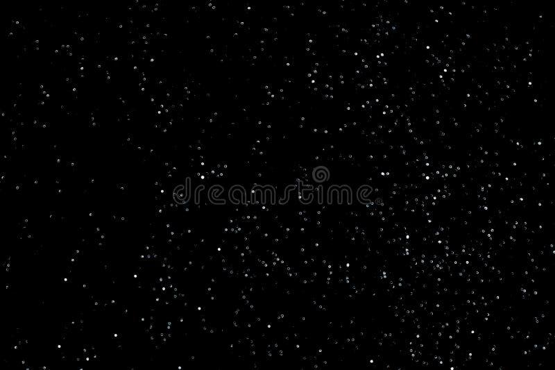 Textur av snö eller stjärnklar himmel som isoleras på svart bakgrund royaltyfri foto
