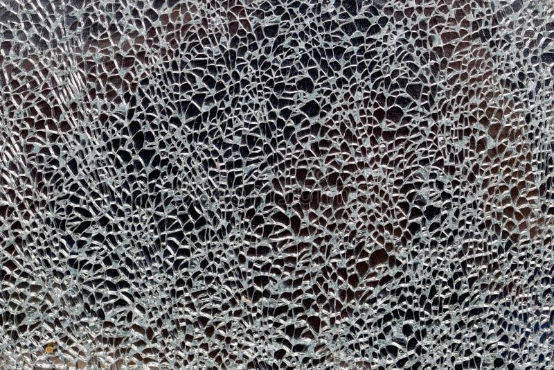 Textur av splittrat exponeringsglas arkivfoto