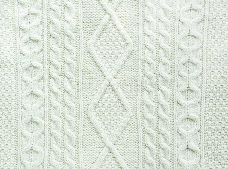 Textur av stuckit handgjort Vitt tröjaslut för jul upp som bakgrundsserve till wallpaperen arkivbilder