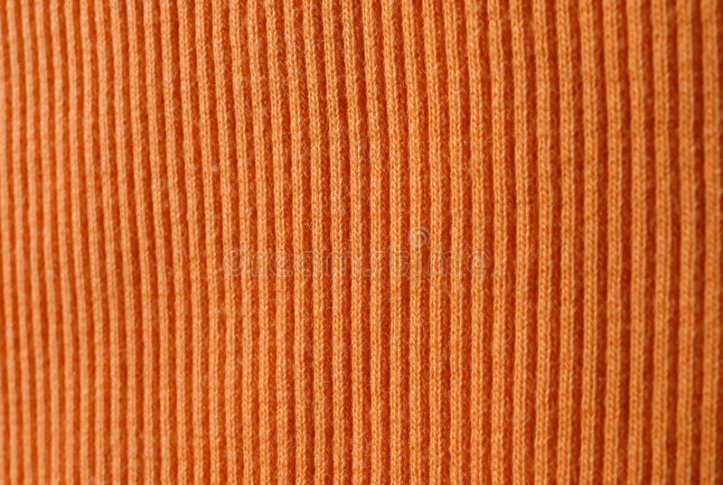 Textur av stuckit orange tyg som bakgrund royaltyfri fotografi