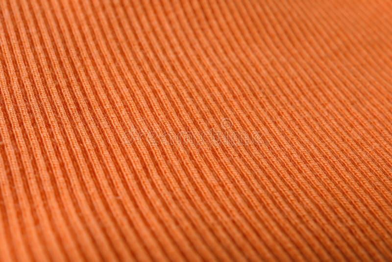 Textur av stuckit orange tyg som bakgrund royaltyfria bilder