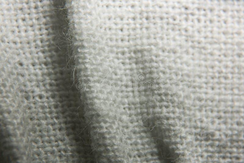 Textur av stuckit tyg i ett ingrepp med veck fotografering för bildbyråer