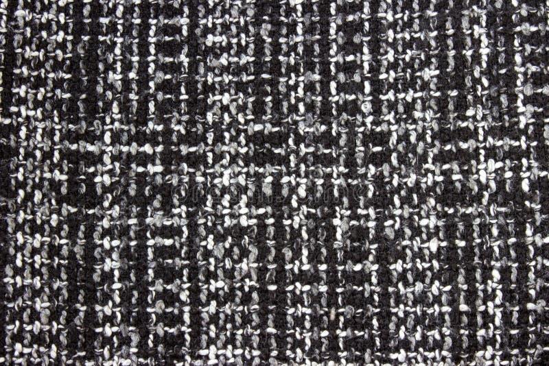 Textur av stuckit woolen tyg för tapet och royaltyfri bild