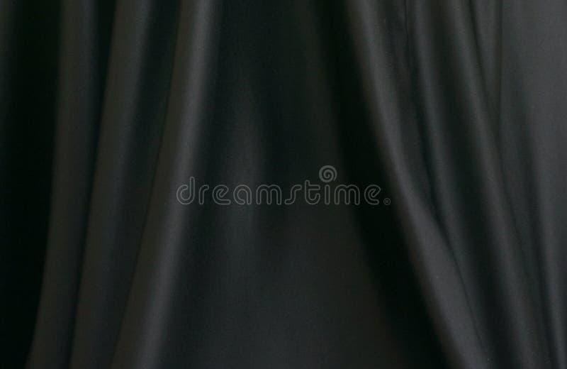 Textur av svart silke fotografering för bildbyråer