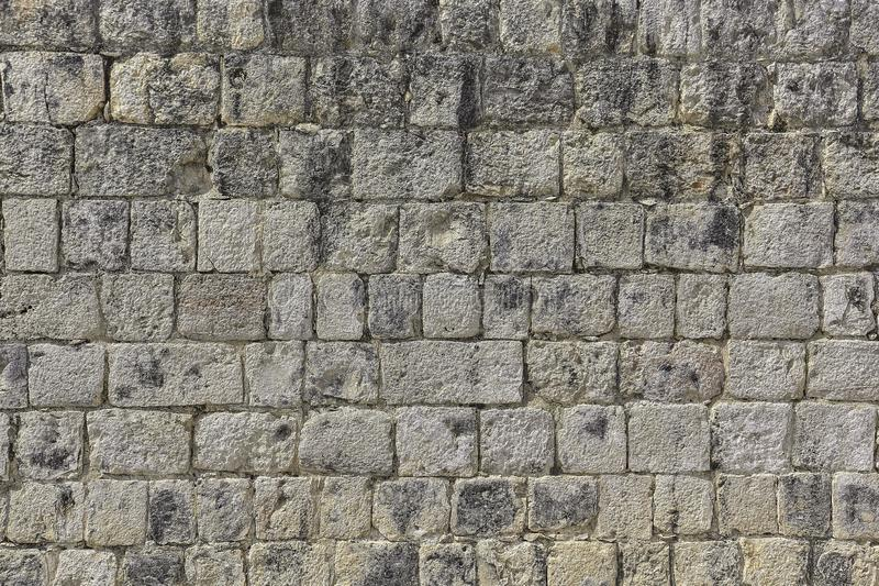Textur av väggen och tegelstenarna på Chichen Itza fotografering för bildbyråer