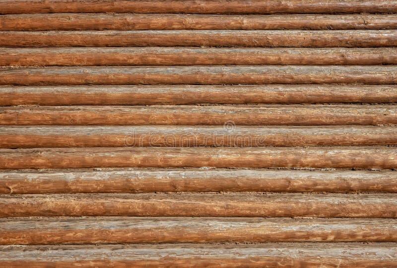 Textur av väggen som göras av gamla träjournaler royaltyfri fotografi