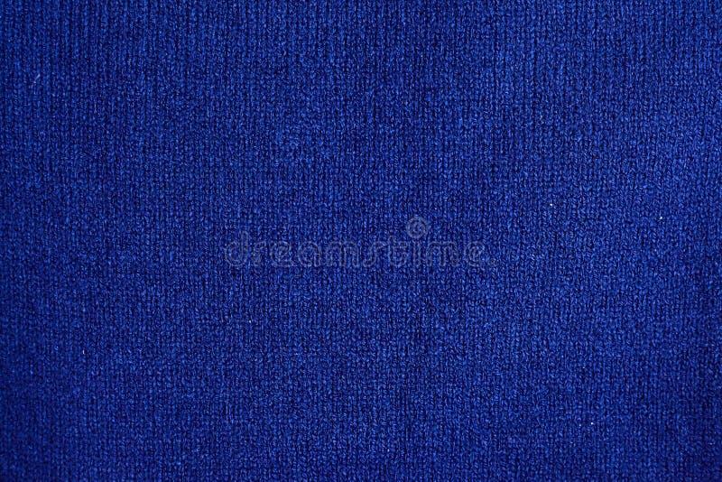 Textur av varm blå stucken vinterkläder royaltyfria foton
