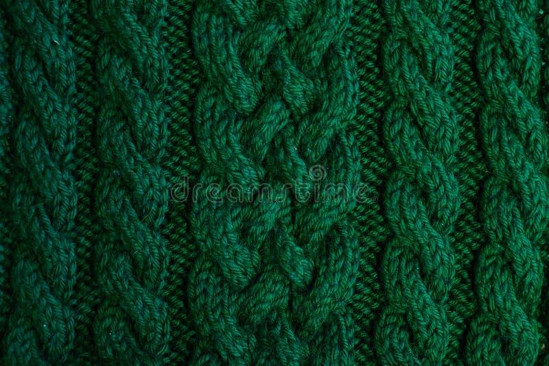 Textur av varm grön stucken vinterkläder royaltyfri fotografi