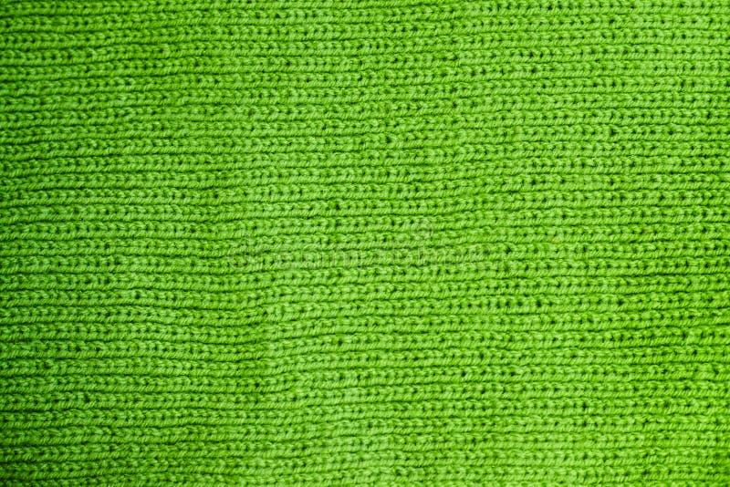 Textur av varm grön stucken vinterkläder arkivfoton