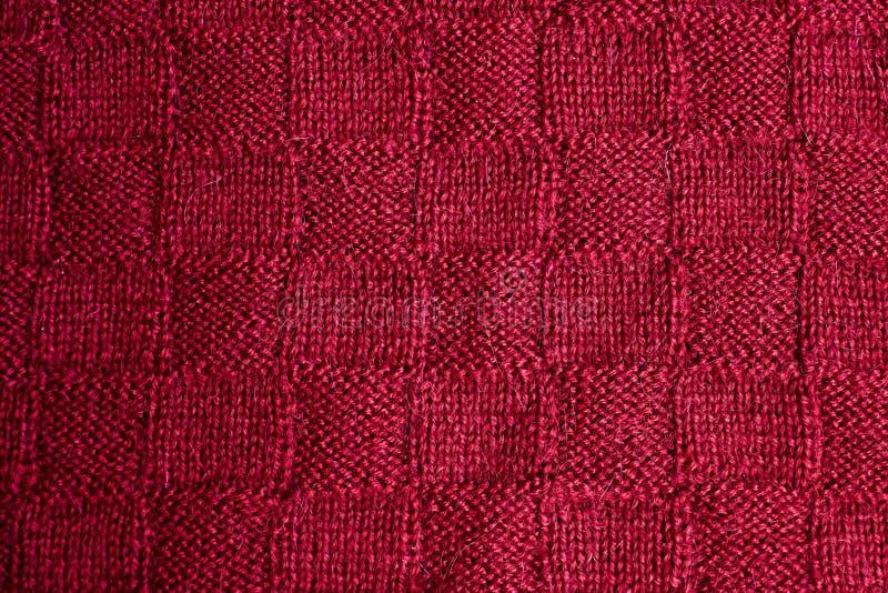 Textur av varm röd stucken vinterkläder royaltyfria foton