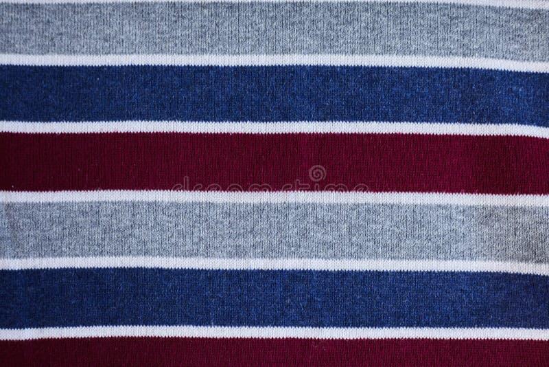 Textur av varm stucken randig kläder royaltyfri bild