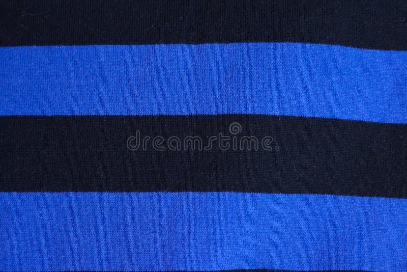 Textur av varm stucken randig kläder royaltyfri fotografi