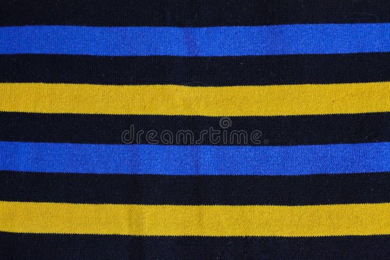 Textur av varm stucken randig kläder arkivbild