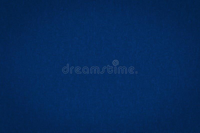 Textur av verkligt mörkt - blått stickade plagg, textilbakgrund royaltyfri bild