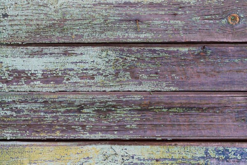 Textur bakgrund, gamla trähorisontalbräden med målarfärgrest royaltyfri foto