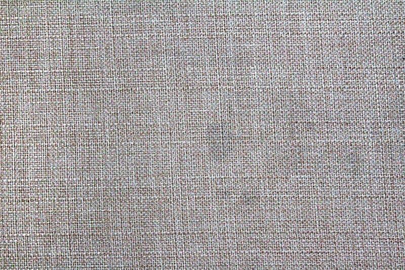 Textur bakgrund som är tät, tyg, tråd, grå färg, färg arkivbild