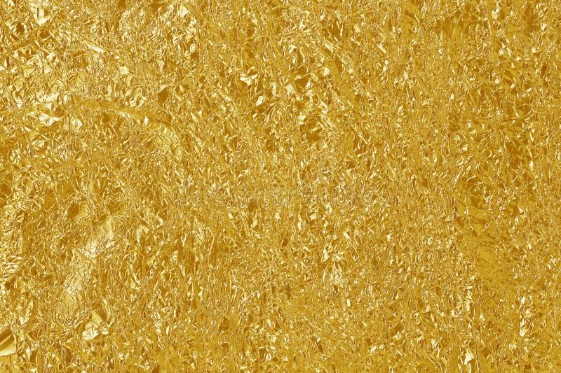 Textur för blad för guld- folie skinande, gult inpackningspapper för abstrakt begrepp royaltyfria foton