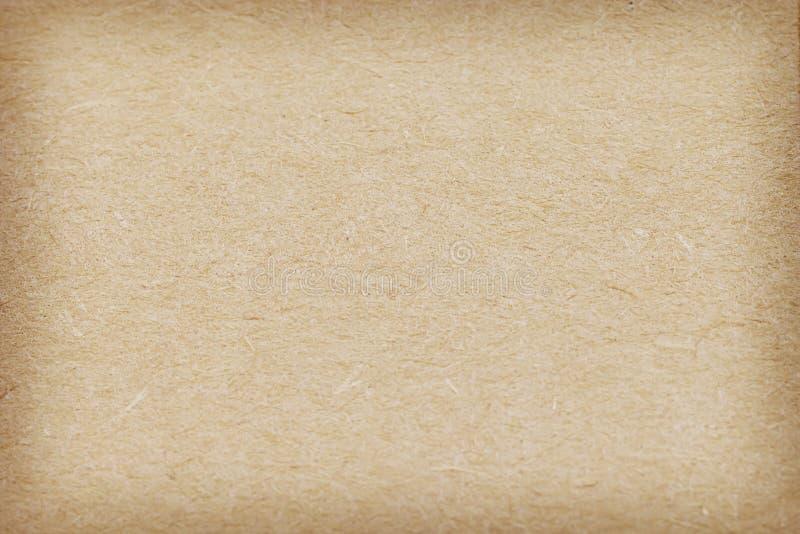 Textur för brunt papper för bakgrund och skugga arkivfoto