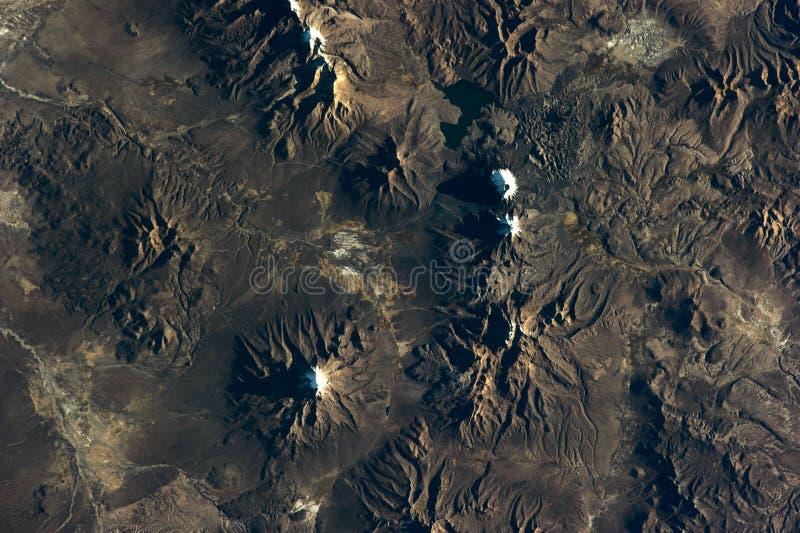 Textur för sikt för chilensk vulkanberglättnad satellit- från jord över Best?ndsdelar av denna avbildar m?blerat av NASA royaltyfri fotografi