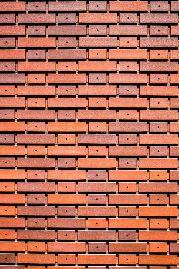 Textur för vägg för brunt för väggtegelplattaapelsin för bakgrund royaltyfri foto