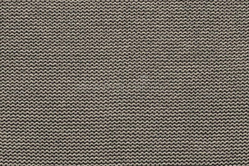 Textur stuckit tyg av grå beige färg arkivfoto