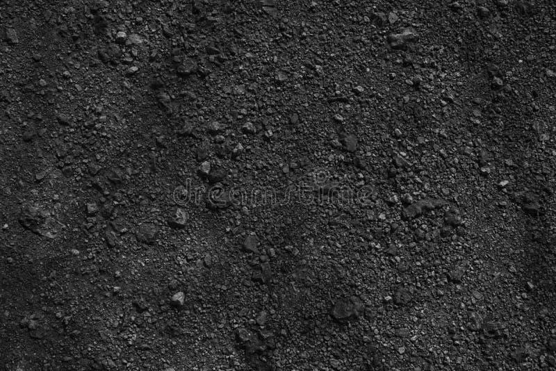 Textura à terra monocromática, superfície da areia, fundo de pedra, bom para o elemento do projeto imagem de stock