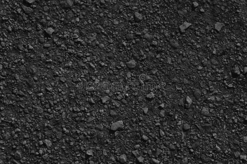 Textura à terra monocromática, superfície da areia, fundo de pedra, bom para o elemento do projeto imagens de stock