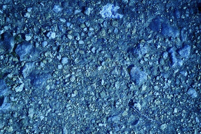 Textura à terra ultra azul, superfície da areia, fundo de pedra, bom para o elemento do projeto fotos de stock royalty free
