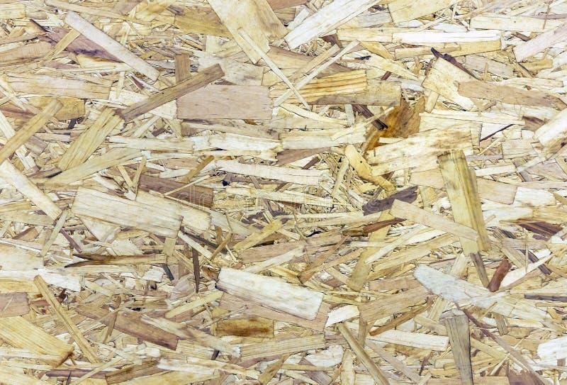 Textura áspera de la madera contrachapada Fondo del conglomerado Placa de un serrín comprimido imagen de archivo libre de regalías