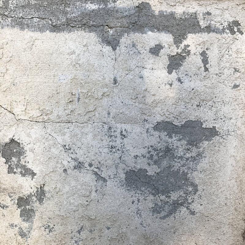 Textura áspera de la pared del cemento en gris con las grietas imagen de archivo