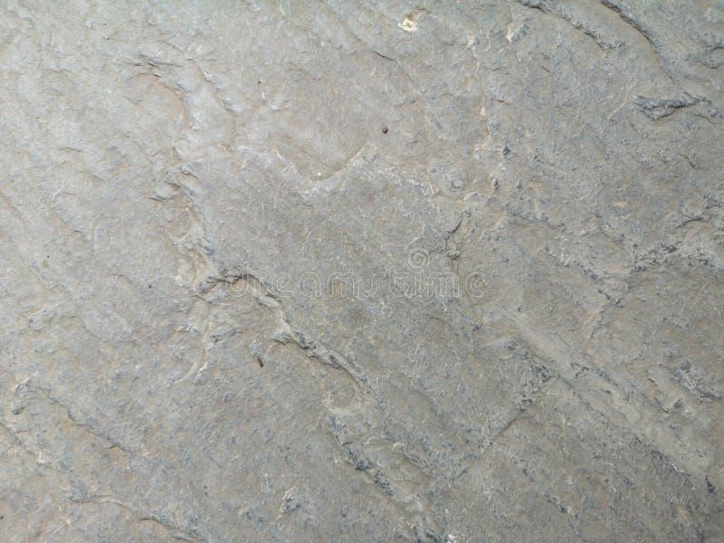 Textura áspera del color del piso de la piedra del fondo gris del material foto de archivo libre de regalías