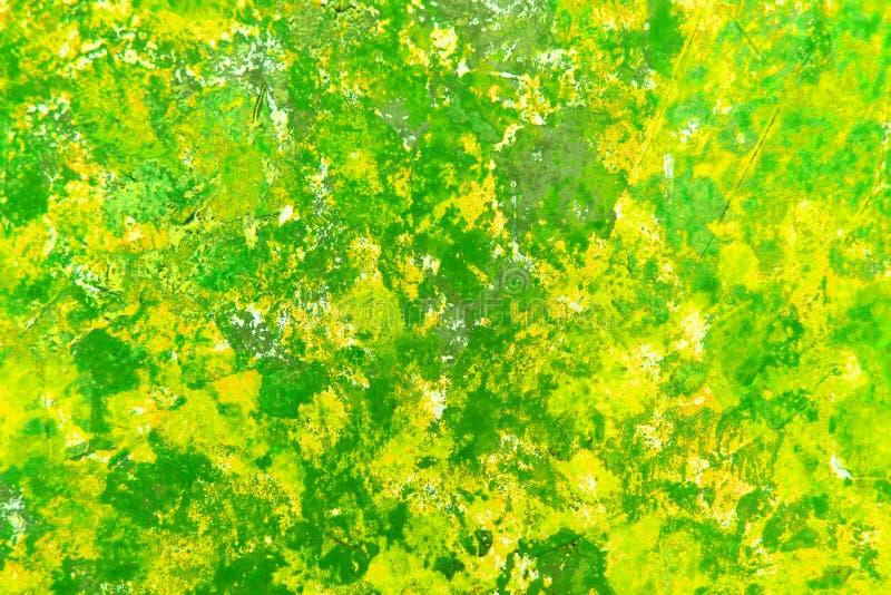 Textura abstracta brillante de la pintura verde y amarilla en lona con una transición del color Textura verde abstracta de la flo imagenes de archivo