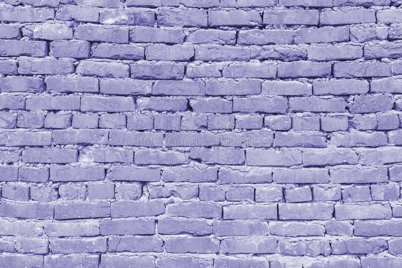 Textura abstracta de la lila o de la pared de ladrillo púrpura, teñida imagen de archivo