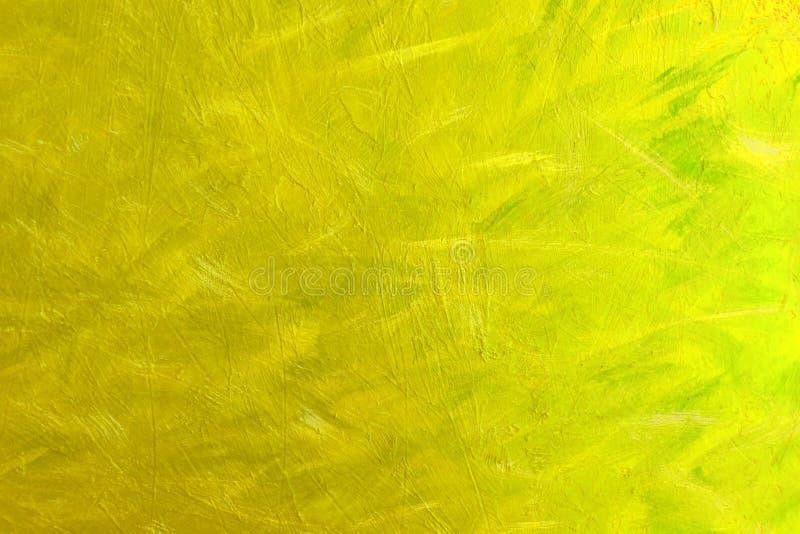 Textura abstracta de la pintura en la lona, fondo en color amarillo fotos de archivo libres de regalías