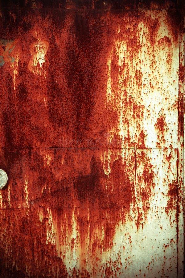 Textura aherrumbrada de la puerta foto de archivo