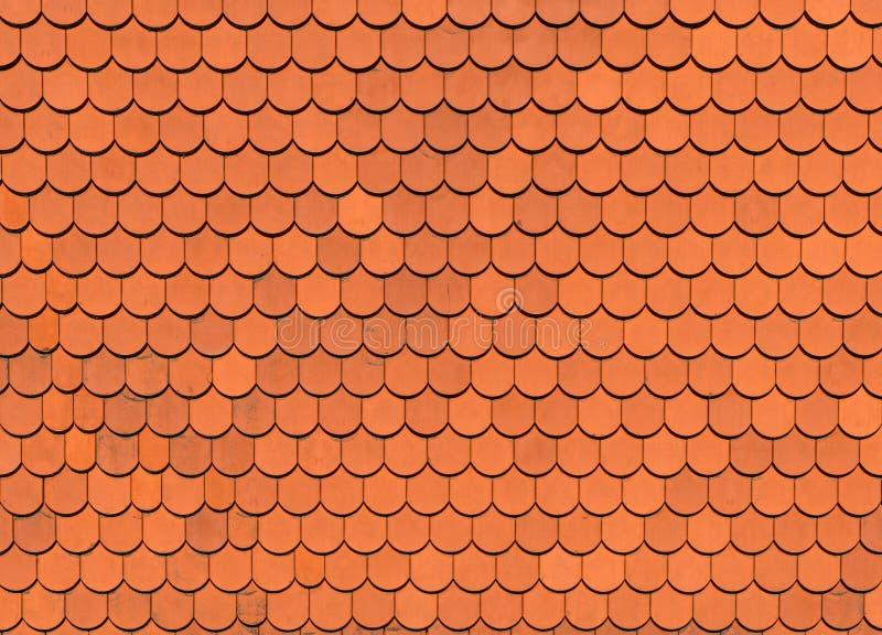 Textura alaranjada da telha de telhado, fundo imagem de stock royalty free