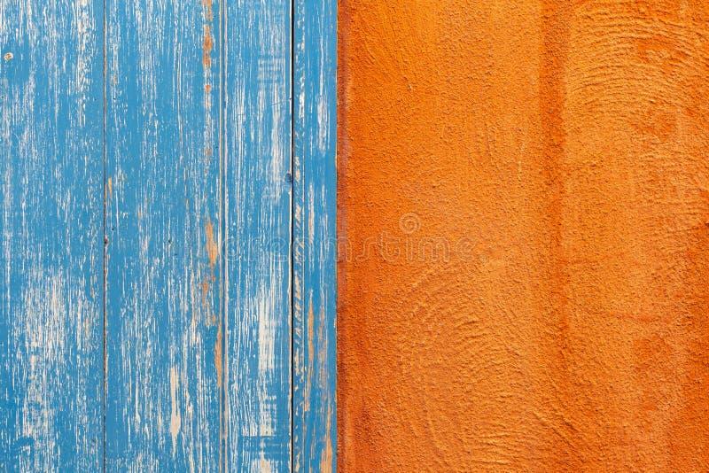 Textura alaranjada e azul da parede imagens de stock
