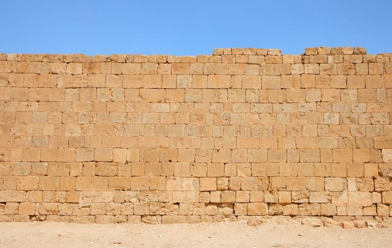 Textura amarela antiga da parede de pedra imagens de stock royalty free