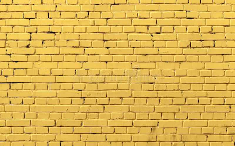 Textura amarela da foto do fundo da parede de tijolo imagem de stock royalty free