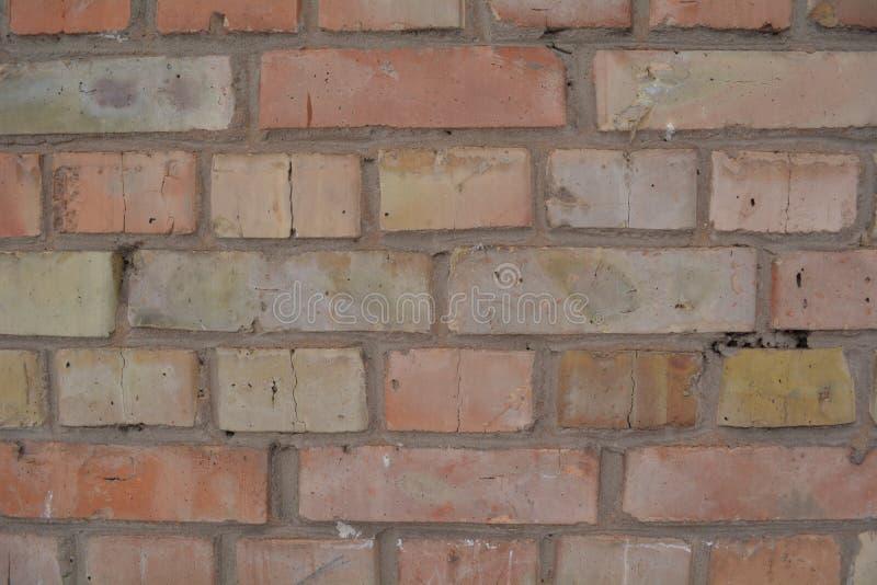 Textura amarela vermelha do fundo da parede de tijolo fotos de stock