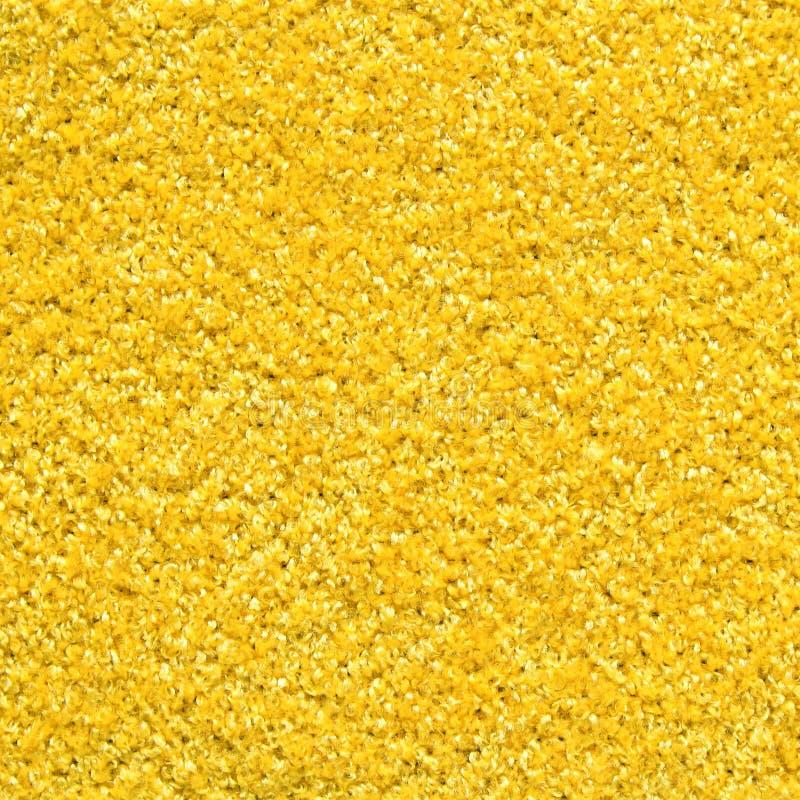 Textura amarilla de la alfombra fotografía de archivo