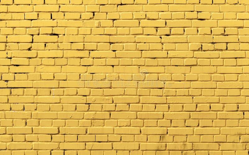 Textura amarilla de la foto del fondo de la pared de ladrillo imagen de archivo libre de regalías