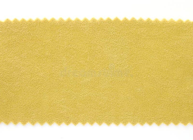 Textura amarilla de las muestras de la muestra de la tela foto de archivo
