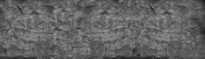 Textura amplia del muro de cemento agrietado negro Viejo panorama resistido de la superficie del cemento Retro panorámico gris os fotos de archivo