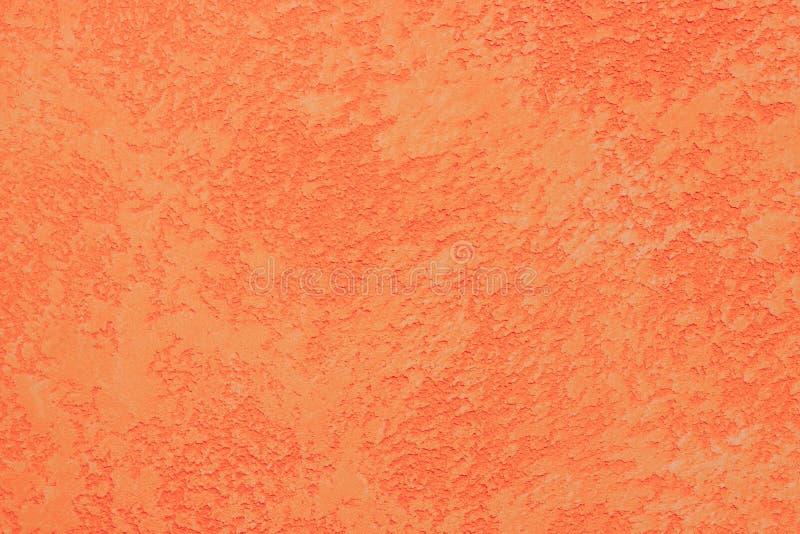 Textura anaranjada vibrante de la pared del yeso Fondo textured extracto fotos de archivo libres de regalías