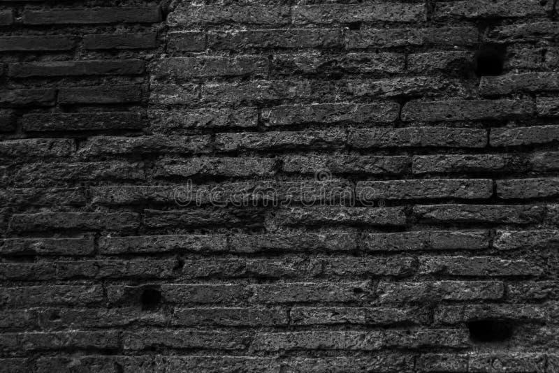 Textura antigua gris de la pared del modelo del ladrillo en Roma imagenes de archivo