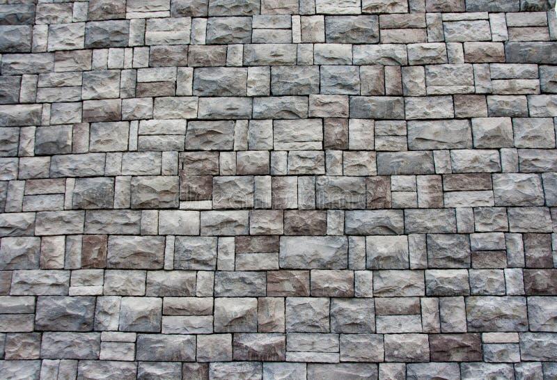 Textura artificial de la pared de piedra foto de archivo - Pared de piedra artificial ...