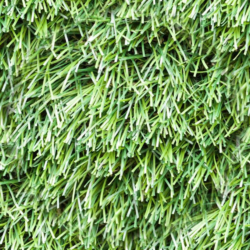 textura artificial inconsútil de la hierba Primer, fondo fotos de archivo libres de regalías
